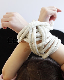 Child's hands with a rope connected