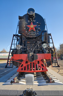 Ancient steam locomotive with red star