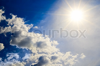bright sun on turn blue sky with cloud