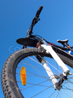 Mountain bike on the background of clear sky