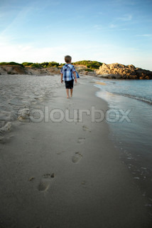 little boy footsteps on the sand