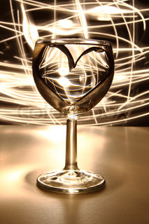valentine heart in the glass of water in the dark night