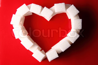 valentine heart from the sugar on the red background
