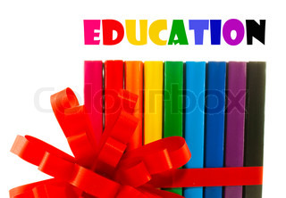 Row of colorful books tied up with ribbon - education concept
