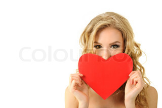 Pretty blond girl holding heart shape