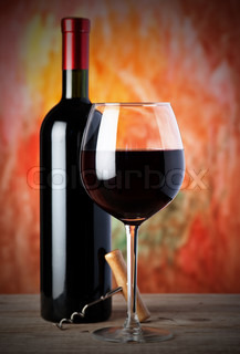 bottle and a wine glass with red wine
