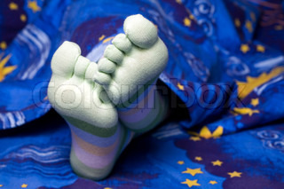 Stock photo: an image of funny feet in striped socks