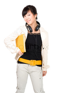 Asian student standing and smiling with yellow book and headphones