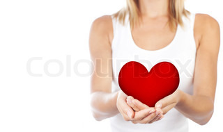Healthy woman holding heart in hands, female body isolated on white background, conceptual image of health care and love, girl with symbol of Valentine's day, selective focus, shallow dof