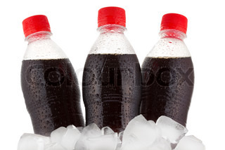 bottles of cola in ice on white background