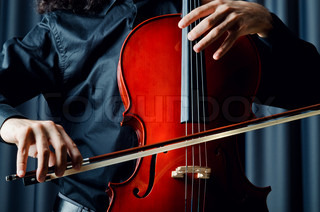 Cello player during performance