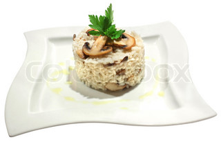 Italian cuisine - risotto with mushrooms and parsley