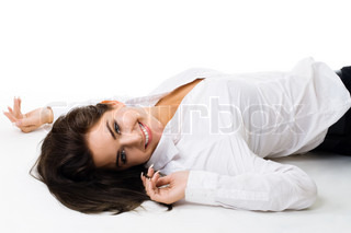 Marvelous Happy Young Woman In White Lay On The Floor And Smiling, Isolated
