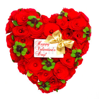 heart shaped red roses with green leaves of clover, golden ribbon and white card for your text