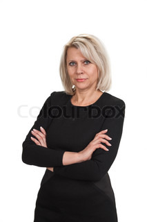 Mature businesswoman standing with arms crossed againstisolated on white background