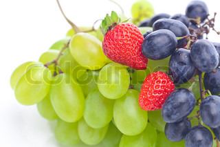 bunch of white and black grapes and strawberries isolated on white