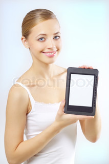 Attractive girl with the e-book reader on a light background