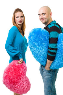 surprised couple with color blue and pink teddy heart,isolated on white