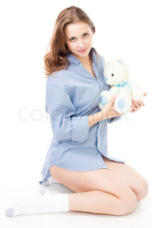 Calm woman with teddy bear, sit in profile, isolated on white