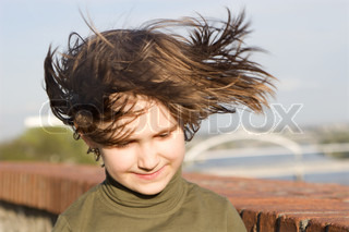 little girl portrait in the wind