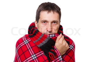 man wrapped in a warm blanket and scarfshivering from the cold on white background