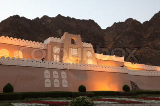 Fortified gate to Muttrah at night Muscat, Sultanate of Oman