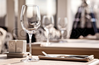 Empty glasses set in restaurant during sunny day