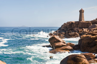 lighthouse in the rocks on Brittany Pink Granite Coast in France