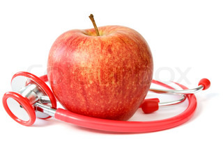 red apple and stethoscope over a white background