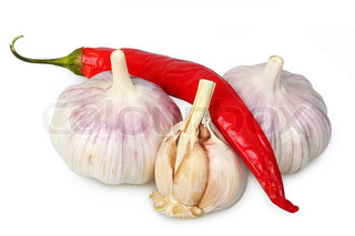 Garlic and red chili peppers on white background