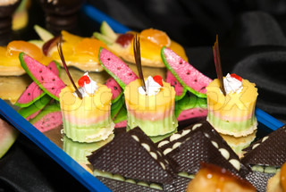 Pieces of cakes and sweets prepared for party