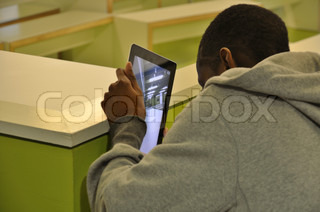 students learning with Apple's iPads and iPhones