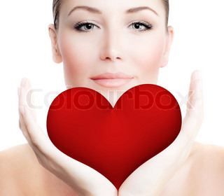 Beautiful woman holding big red heart in hands, sensual female portrait isolated on white background, cute girl expressing tender feelings, conceptual image of health care and love
