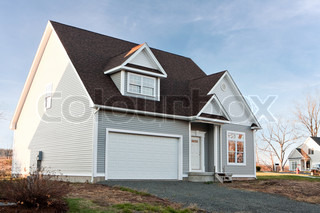 Modern custom built house newly constructed with a two car garage in a residential neighborhood