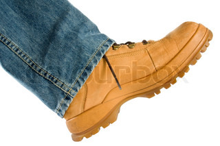 Male foot in brown shoe walking on white background