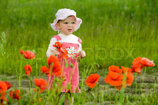 An image of baby amongst field with flowers