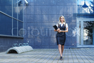Business woman walking in the street
