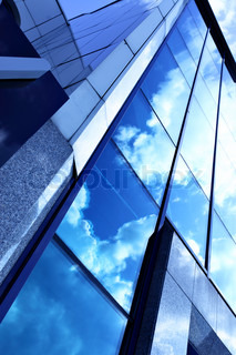 Glass wall of business center and sky reflection, may be used as background