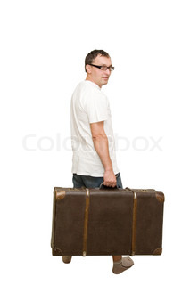 Man carrying an old suitcase (isolated on white)