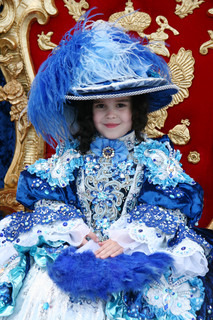Smiling little girl wearing an antique princess dress