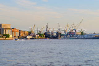 Petersburg, View of the industrial part of town Port cranes, shipyard, docks on river Neva