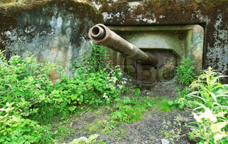 Old abandoned military pillbox with a tank cannon