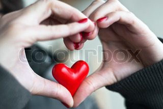 Heart of hands and small heart inside