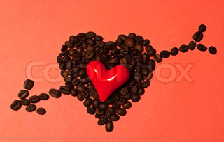Little red heart in big coffee heart with arrow