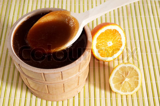 A pail with honey and slice of lemon
