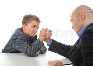 little boy and a man businessman arm wrestling Isolated on white background