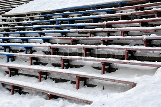 Closeup image of bandy stadium stands in the winter in Russia