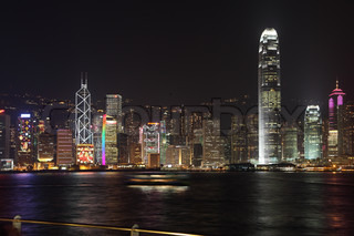 The magnificent panorama of the night in Hong Kong Ultra-modern skyscrapers of Hong Kong night lights shining on the sea shore