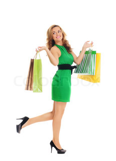 Attractive woman doing shopping isolated on white