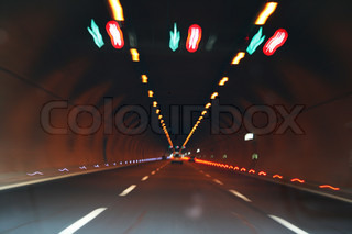 Lights and car in tunnel